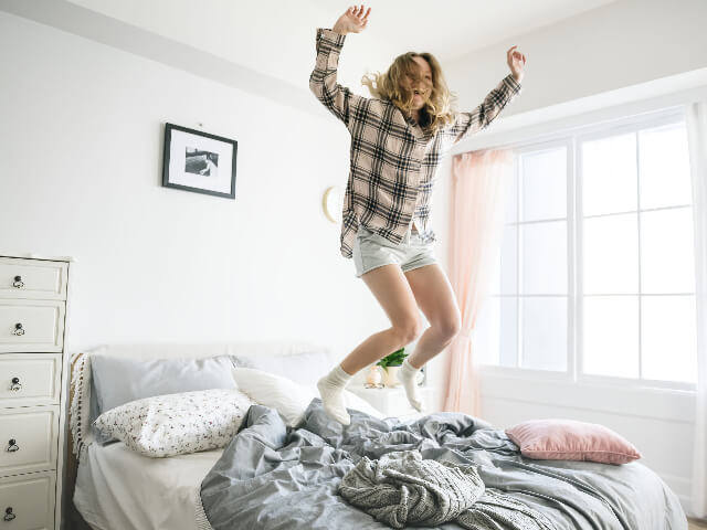 Top five millennial real estate trends - millennial jumping up and down